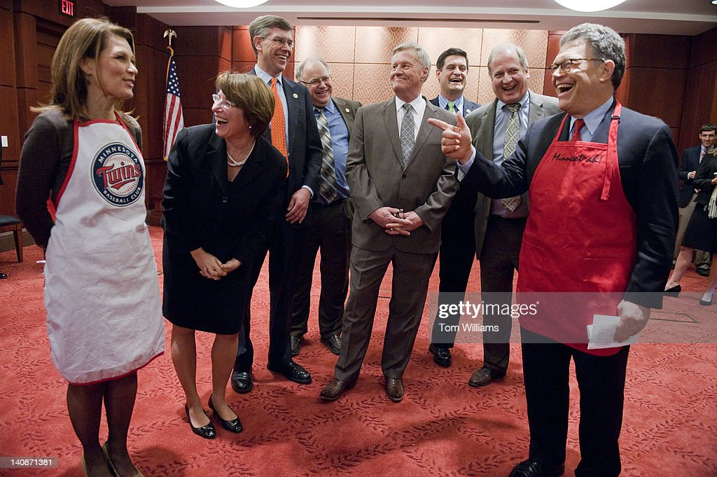 From left, Rep. Michele Bachmann, R-Minn., Sen. Amy Klobuchar, D-Minn., Reps. Erik Paulsen, R-Minn., Tim Walz, D-Minn., Collin Peterson, D-Minn., Chip Cravaack, R-Minn., former Rep. Vin Weber, R-Minn., and Sen. Al Franken, D-Minn., prepare for the second annual 'hotdish' competition in the Capitol Visitor Center, featuring casserole-like dishes from members of the Minnesota Congressional Delegation. The dishes of Sen. Franken and Rep. Chip Cravaack, R-Minn., tied for first place in the competition.