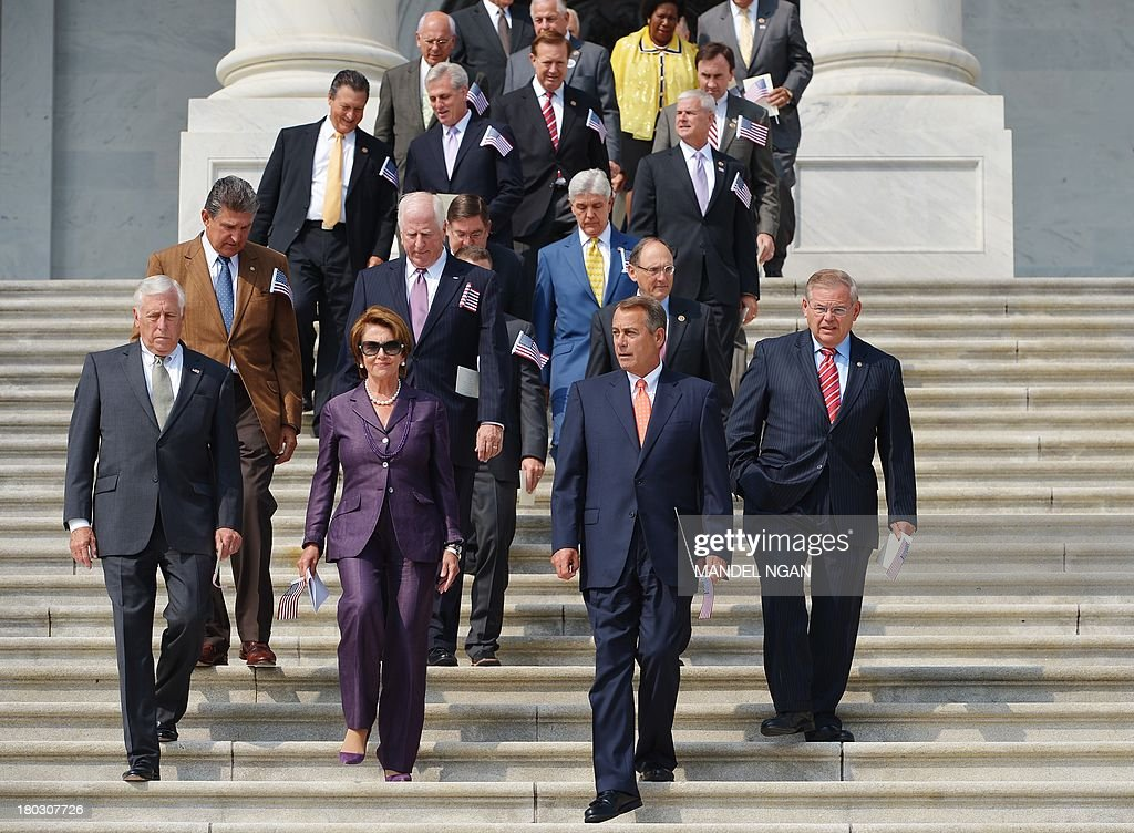 Rep. Steny Hoyer, D-MD, House Minority Leader <a gi-track='captionPersonalityLinkClicked' href=/galleries/search?phrase=Nancy+Pelosi&family=editorial&specificpeople=169883 ng-click='$event.stopPropagation()'>Nancy Pelosi</a>, House Speaker John Boehner, R-OH, Senator Robert Menendez, D-NJ, arrive for the 12th anniversary 9/11 Remembrance ceremony on the East Steps of the US Capitol on September 11, 2013 in Washington, DC. AFP PHOTO/Mandel NGAN