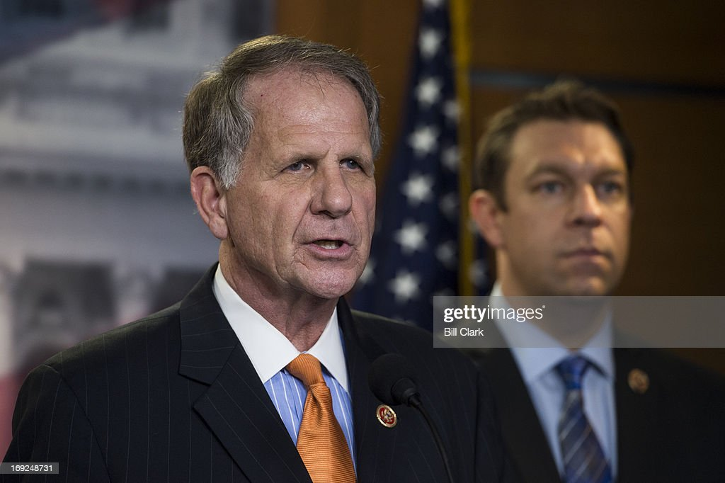 From left, Rep. Ted Poe, R-Texas, and Rep. Trey Radel, R-Fla., hold a news conference at the Capitol on H.R.1962, the 'Free Flow of Information Act of 2013' on Wednesday, May 22, 2013. The legislation would 'increase protections for members of the media by providing a qualified privilege that prevents a reporter's source material from being revealed to government investigators except under narrow circumstances, such as where necessary to prevent an act of terrorism or other significant and specified harm to national security.'