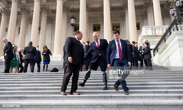 From left Repelect Lou Correa DCalif Repelect Brian Mast RFla and Repelect Scott Taylor RVa walk down the House steps following the 115th Congress...