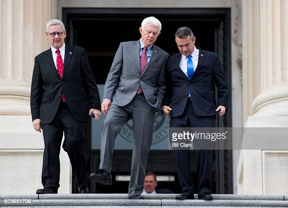 From left Repelect Paul Mitchell RMich Repelect Jack Bergman RMich and Repelect Don Bacon RNeb walk down the House steps for the 115th Congress...