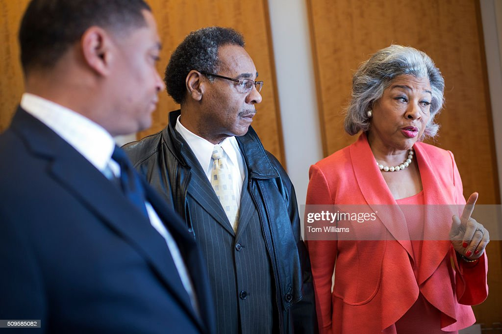 From left, Reps. Cedric Richmond, D-La., Emanuel Cleaver, D-Mo., and Joyce Beatty, D-Ohio, talk with a reporter after a news conference at the DNC where members of the Congressional Black Caucus PAC endorsed Hillary Clinton for president, February 11, 2016.