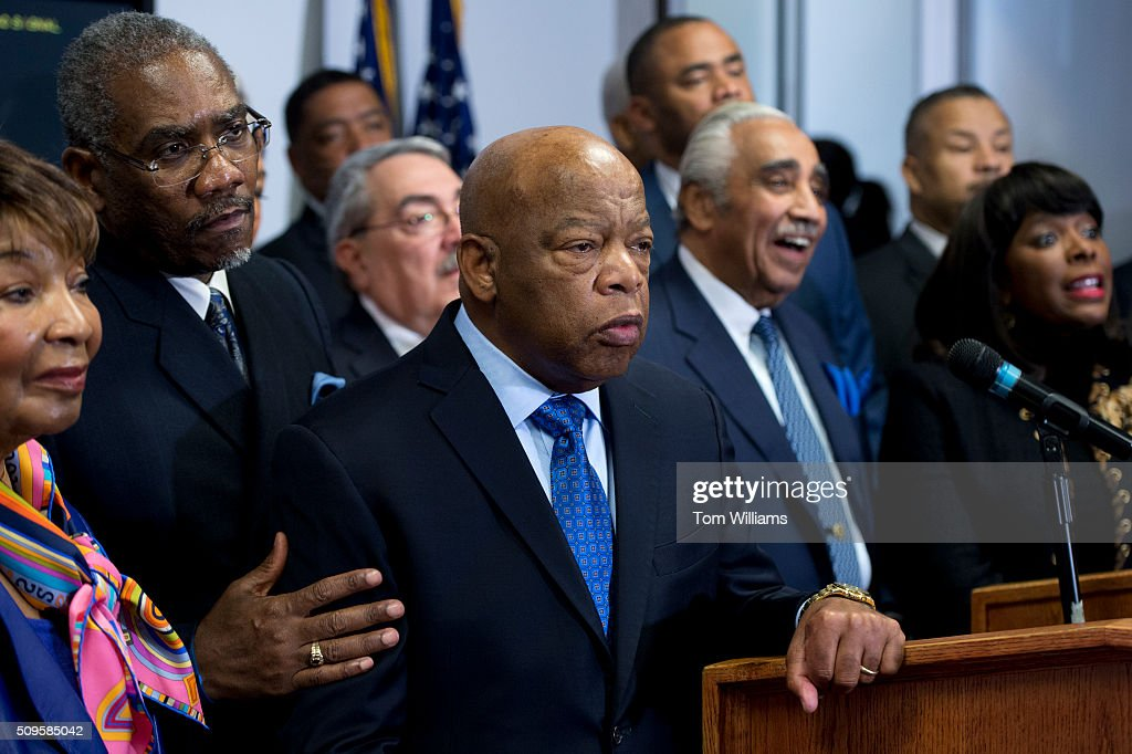 From left, Reps. Eddie Bernice Johnson, D-Texas, Gregory Meeks, D-N.Y., chairman of the Congressional Black Caucus PAC, Cedric Richmond, D-La., G.K. Butterfield, chairman of the CBC, John Lewis, D-Ga., Marc Veasey, D-Texas, Charlie Rangel, D-N.Y., Donald Payne, Jr., D-N.J., and Terri Sewell, D-Ala., conduct a news conference at the DNC where members of the CBC PAC endorsed Hillary Clinton for president, February 11, 2016.