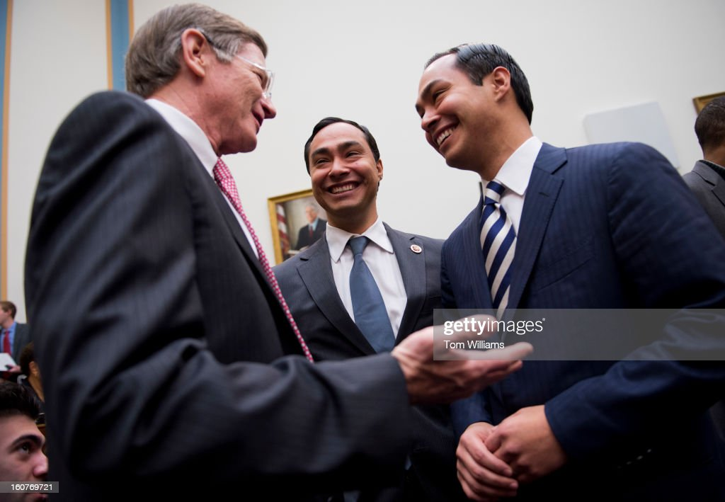 From left Reps Lamar Smith RTexas Joaquin Castro DTexas and his brother Julian Castro mayor of San Antonio talk before a House Judiciary Committee...
