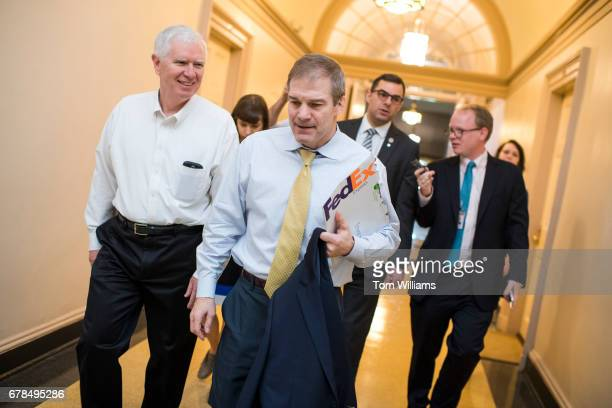 From left Reps Mo Brooks RAla Jim Jordan ROhio and Justin Amash RMich leave a meeting of the House Republican Conference in the Capitol on the day...