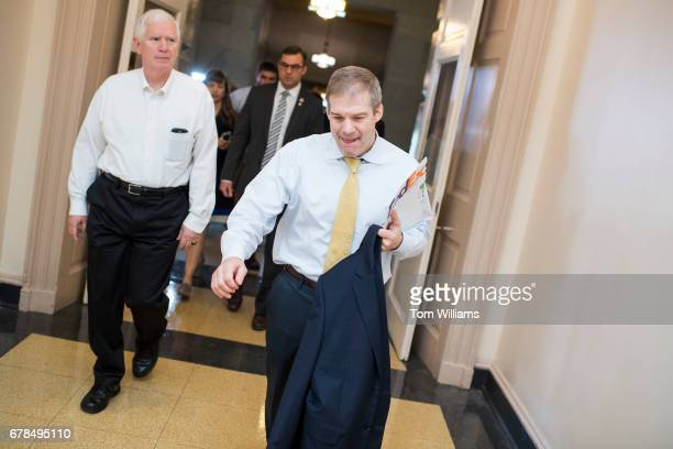 From left Reps Mo Brooks RAla Justin Amash RMich and Jim Jordan ROhio leave a meeting of the House Republican Conference in the Capitol on the day...