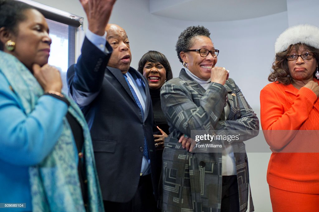 From left, Reps. Sheila Jackson Lee, D-Texas, John Lewis, D-Ga., Terri Sewell, D-Ala., Marcia Fudge, D-Ohio, and Corrine Brown, D-Fla., attend a news conference at the DNC where members of the Congressional Black Caucus PAC endorsed Hillary Clinton for president, February 11, 2016.