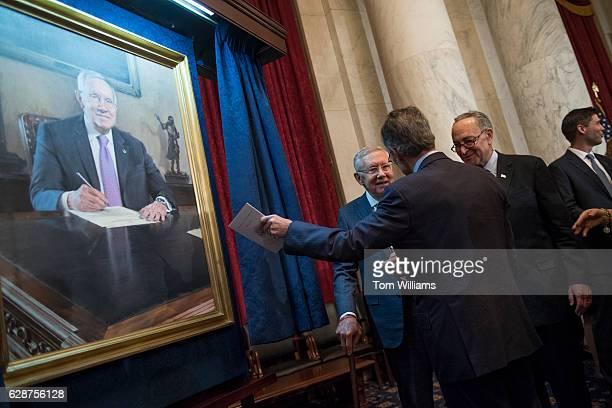 From left retiring Senate Minority Leader Harry Reid DNev former Sen Tom Daschle DSD and incoming Senate Minority Leader Charles Schumer DNY attend...