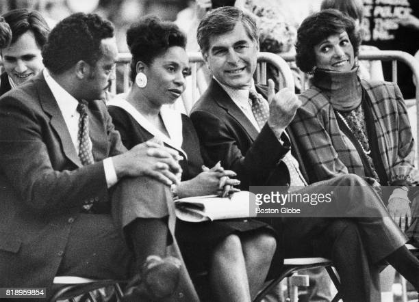 From left Reverend Jesse L Jackson his wife Jacqueline Governor Michael Dukakis and his wife Kitty at the Boston Pops concert on the Charles River...