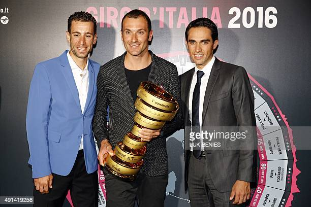 Riders Vincenzo Nibali of Italy Ivan Basso of Italy and Alberto Contador of Spain pose with the trophy of the Giro d'Italia 'Trofeo Senza Fine'...