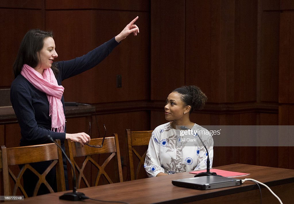 From left, Sarah Hughes, 2002 Olympic gold medalist figure skater, talks with Dominique Dawes, three-time Olympic gymnast and co-chairman of the President's Council on Fitness, Sports and Nutrition, before the start of The National Girls and Women in Sports Day Coalition media briefing on why sports matter for girls, commemorating the 27th annual National Girls and Women in Sports Day (NGWSD) on Tuesday, Feb. 5, 2013.