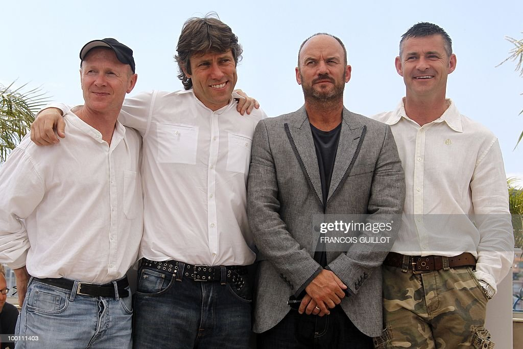 screenwriter Paul Laverty, British actors <a gi-track='captionPersonalityLinkClicked' href=/galleries/search?phrase=John+Bishop+-+Actor&family=editorial&specificpeople=7360807 ng-click='$event.stopPropagation()'>John Bishop</a>, Mark Womack and Trevor Williams pose during the photocall 'Route Irish' presented in competition at the 63rd Cannes Film Festival on May 21, 2010 in Cannes.