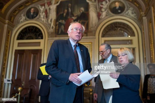 From left Sen Bernie Sanders IVt Senate Minority Leader Charles Schumer DNY and Sen Patty Murray DWash are seen in the Capitol's Senate Reception...