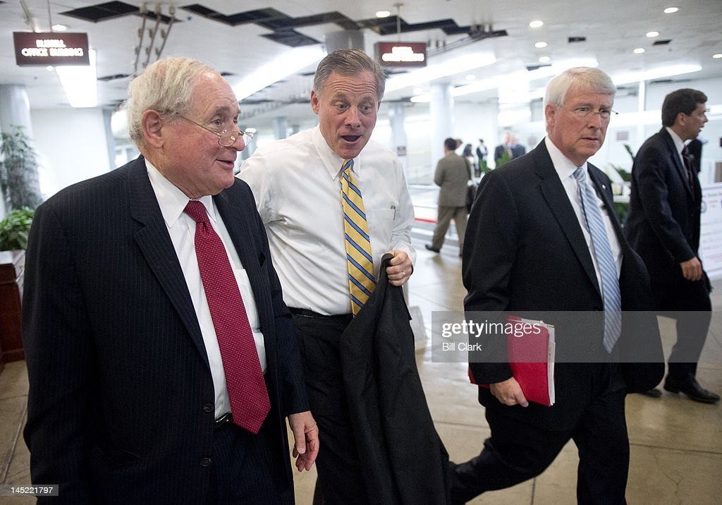 From left, Sen. Carl Levin, D-Mich., Sen. Richard Burr, R-N.C., and Sen. Roger Wicker, R-Miss., arrive in the Capitol via the Senate subway for votes on the Food and Drug Administration reauthorization bill on Thursday, May 24, 2012.