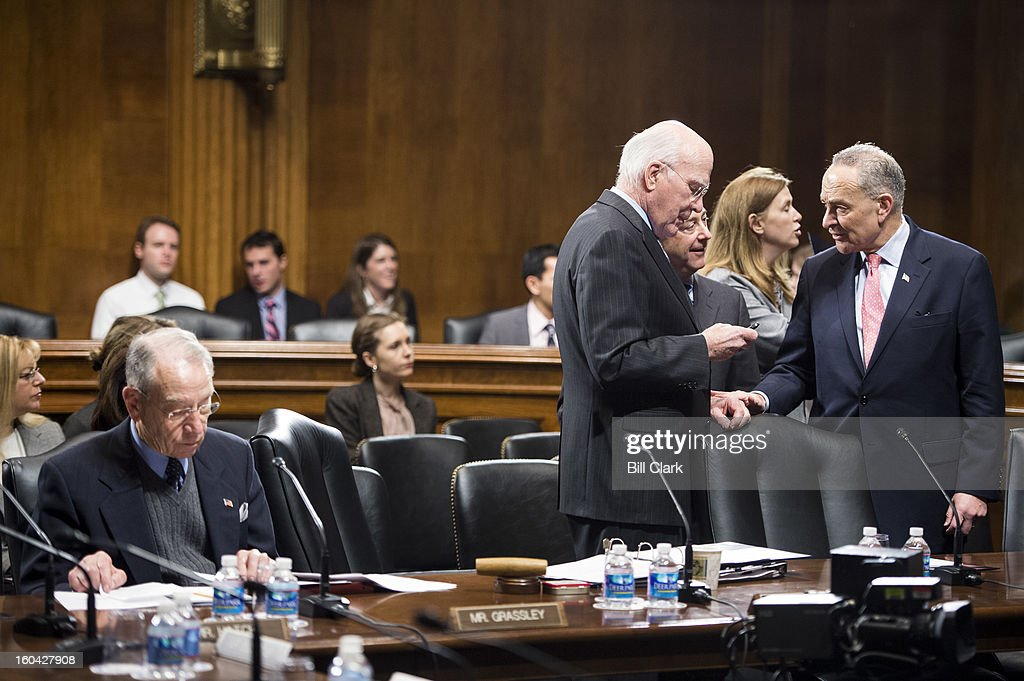From left, Sen. Charles Grassley, R-Iowa, looks over papers as Chairman Patrick Leahy, D-Vt., Bruce Cohen, Staff Director of the Senate Judiciary Committee, and Sen. Chuck Schumer, D-N.Y., talk before the start of the Senate Judiciary Committee meeting to organize for the 113th Congress on Thursday, Jan. 31, 2013.