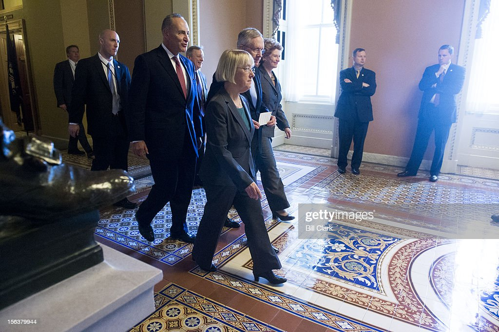 From left, Sen. Charles Schumer, D-N.Y., Sen. Richard Durbin, D-Ill., Sen. Patty Murray, D-Wash., Senate Majority Leader Harry Reid, D-Nev., and Sen. Debbie Stabenow, D-Mich., make their way to the Ohio Clock Corridor to speak with reporters following the Senate Democrats' caucus leadership elections on Wednesday, Nov. 14, 2012.