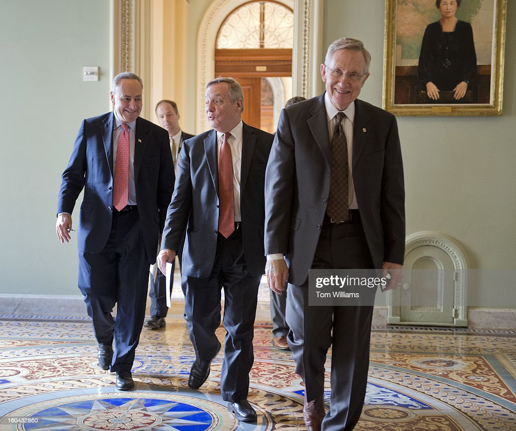 From left, Sen. Chuck Schumer, D-N.Y., Senate Majority Whip Richard Durbin, D-Ill., and Senate Majority Leader Harry Reid, D-Nev., make their way to a news conference in the Capitol on immigration reform.
