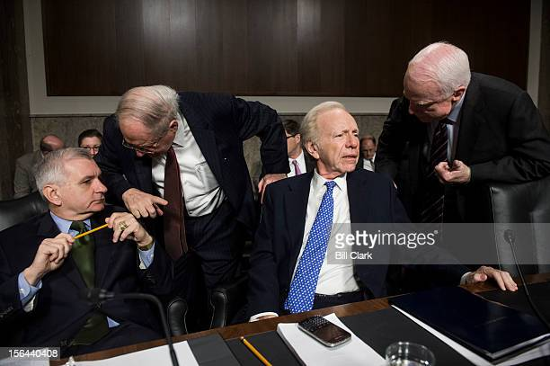 From left Sen Jack Reed DRI Chairman Carl Levin DMich Sen Joe Lieberman IConn and ranking member John McCain RAriz speak before the start of the...