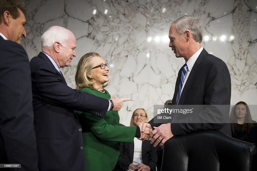 From left, Sen. Jeff Flake, R-Ariz., Sen. John McCain, R-Ariz., Secretary of State Hillary Clinton and Sen. Ron Johnson, R-Wisc., talk before the start of the Senate Foreign Relations Committee hearing on the September 11th attacks against the U.S. mission in Benghazi on Wednesday morning, January 23, 2013.