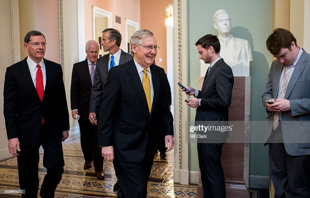 From left, Sen. John Barrasso (R-WY) Sen. John Cornyn (R-TX) Sen. John Thune (R-SD) and Senate Majority Leader Mitch McConnell (R-KY) walks to the podium to speak to the media following the Senate Republicans' policy lunch on Tuesday, May 24, 2016.