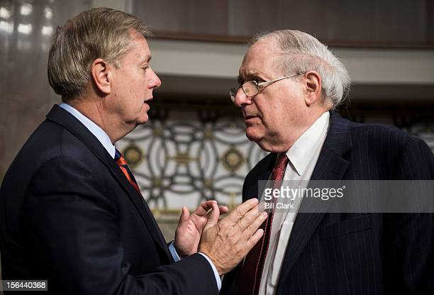 From left Sen Lindsey Graham RSC speaks with Chairman Carl Levin DMich before the start of the Senate Armed Services Committee confirmation hearing...