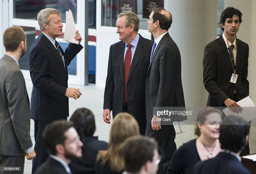 From left, Sen. Max Baucus, D-Mont., Mike Crapo, R-Idaho, and Sen. Ron Wyden, D-Ore., talk as they arrive in the Capitol for a vote Tuesday, Dec. 4, 2012.
