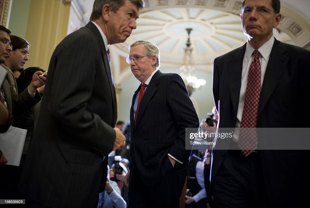 From left, Sen. Roy Blunt, R-Mo., Senate Minority Leader Mitch McConnell, R-Ky., and Sen. John Barrasso, R-Wyo., Republican Policy Committee chairman, conclude a news conference in the Ohio Clock Corridor after the senate luncheons in the Capitol.