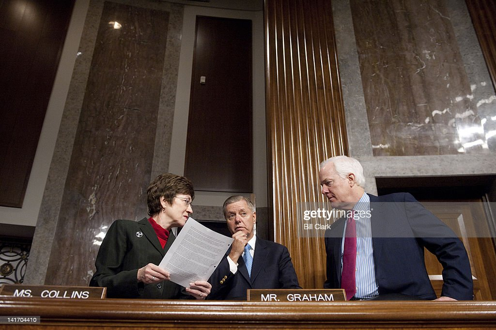 From left, Sen. Susan Collins, R-Maine, Sen. Lindsey Graham, R-S.C., and Sen. John Cornyn, R-Texas, talk before the start of the Senate Armed Services Committee hearing on the situation in Afghanistan on Thursday, March 22, 2012.