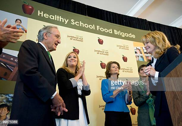 From left Senate Agriculture Chairman Tom Harkin DIowa is introduced as the first speaker as actress Andrea Bowen Sen Lisa Murkowski RAlaska Rep Rosa...