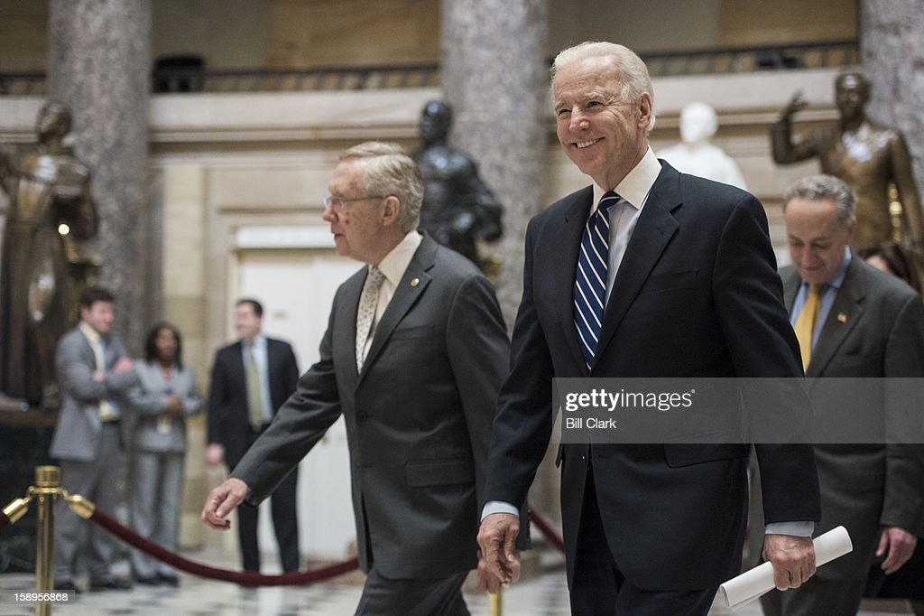 From left, Senate Majority Leader Harry Reid, D-Nev., Vice President Joe Biden and Sen. Charles Schumer, D-N.Y., follow the Senate pages as they carry the presidential electoral ballots through Statuary Hall to the House chamber for the ballot counting on the House floor on Friday, Jan. 4, 2013.