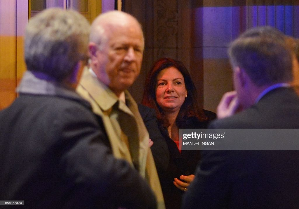 Senator Kelly Ayotte (2nd R), R-NH, and Senator Saxby Chambliss (2nd L), R-GA, are seen outside the Jefferson Hotel following a dinner with US President Barack Obama and a group of fellow Republican senators on March 6, 2013 in Washington, DC. President Obama met Republican senators for a rare dinner March 6, 2013, as he sought to end an ugly budget stalemate that is clouding the early days of his second term. AFP PHOTO/Mandel NGAN