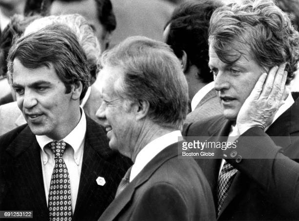 From left Senator Paul Tsongas President Jimmy Carter and Senator Edward M Kennedy are pictured at Logan Airport in Boston as the President arrives...