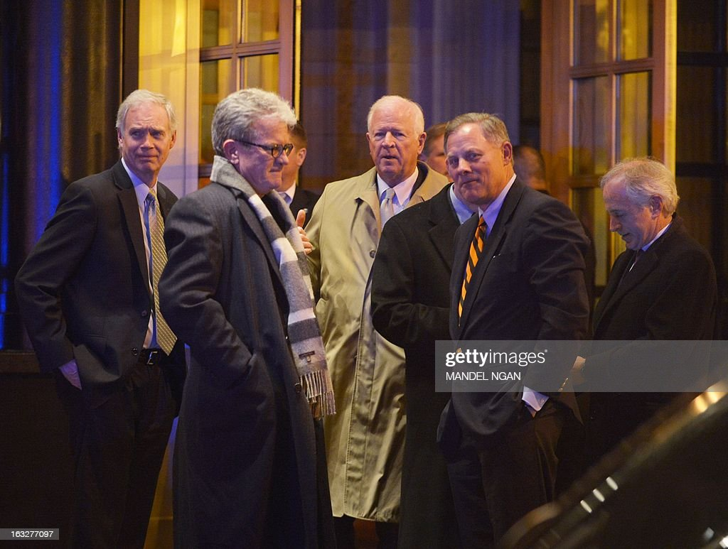 Senator Ron Johnson, R-WI, Senator Thomas Coburn, R-OK, Senator Saxby Chambliss, R-GA, Senator Richard Burr, R-NC, and Senator Bob Corker, R-TN, are seen outside the Jefferson Hotel following a dinner with US President Barack Obama and a group of fellow Republican senators on March 6, 2013 in Washington, DC. President Obama met Republican senators for a rare dinner March 6, 2013, as he sought to end an ugly budget stalemate that is clouding the early days of his second term. AFP PHOTO/Mandel NGAN