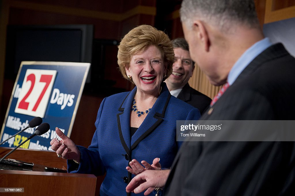 From left, Sens. Debbie Stabenow, D-Mich., Mark Begich, D-Alaska, and Chuck Schumer, D-N.Y., attend a news conference in the Capitol calling on the House to act on a Senate passed tax cut bill that would help the middle class.