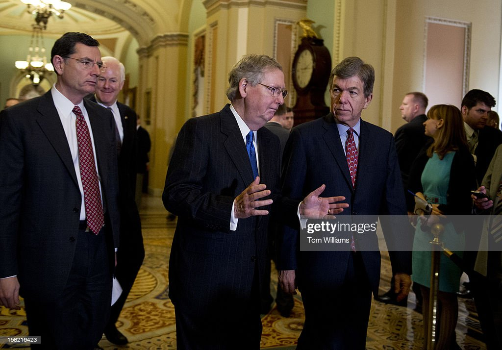 From left, Sens. John Barrasso, R-Wyo., John Cornyn, R-Texas, Senate Minority Leader Mitch McConnell, R-Ky., and Sen. Roy Blunt, R-Mo., arrive for a news conference in the Ohio Clock Corridor after the senate luncheons in the Capitol. The impending 'fiscal cliff' was mainly discussed.