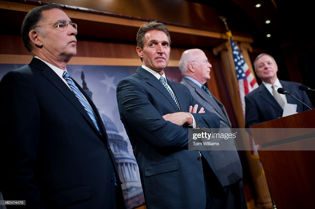From left, Sens. <a gi-track='captionPersonalityLinkClicked' href=/galleries/search?phrase=John+Boozman&family=editorial&specificpeople=3099782 ng-click='$event.stopPropagation()'>John Boozman</a>, R-Ark., <a gi-track='captionPersonalityLinkClicked' href=/galleries/search?phrase=Jeff+Flake&family=editorial&specificpeople=2474871 ng-click='$event.stopPropagation()'>Jeff Flake</a>, R-Ariz., Patrick Leahy, D-Vt., and Minority Whip Richard Durbin, D-Ill., conduct a news conference in the Capitol's Senate studio on legislation that would end the U.S. travel ban on Cuba, January 29, 2015.