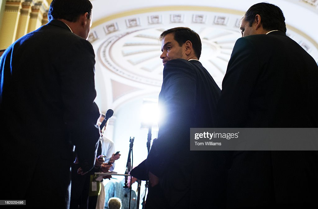 From left, Sens. Mike Lee, R-Utah, Marco Rubio, R-Fla., and Ted Cruz, R-Texas, speak to the media after the Senate voted to pass the continuing resolution.