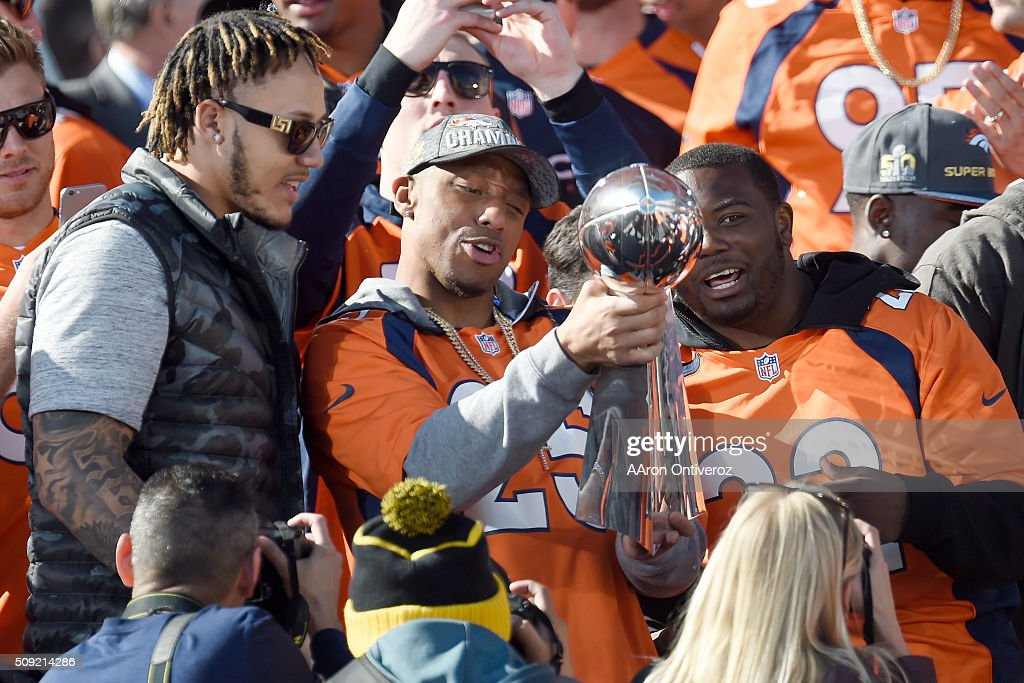 From left, Shane Ray, Chris Harris Jr., and CJ Anderson celebrate with the Lombardi Trophy during the Denver Broncos Super Bowl championship celebration and parade on Tuesday February 9, 2016.