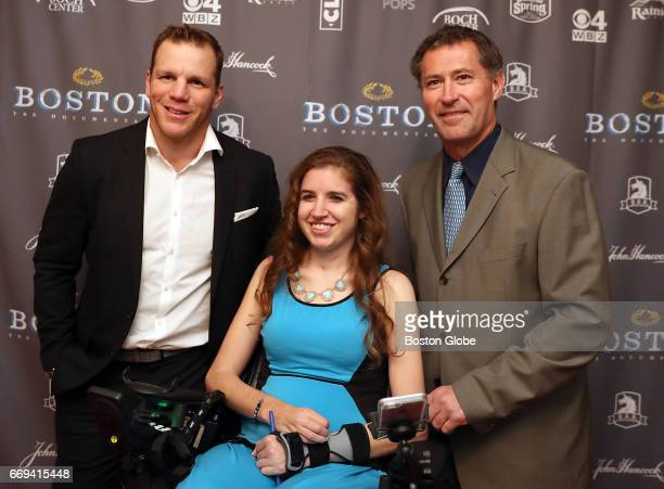 From left Shawn Thorton Denna Laing and Bobby Carpender are pictured on the red carpet for the premiere of the Boston Marathon documentary 'Boston'...