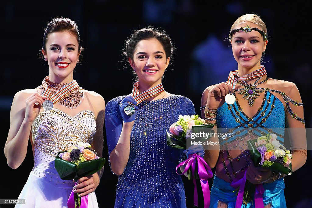 From left, silver medalist Ashley Wagner of the United States, gold medalist Evgenia Medvedeva of Russia, and bronze medalist Anna Pogorilaya of Russia stand on the podium following the Ladies Free Skate program on Day 6 of the ISU World Figure Skating Championships 2016 at TD Garden on April 2, 2016 in Boston, Massachusetts.
