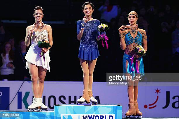 From left silver medalist Ashley Wagner of the United States gold medalist Evgenia Medvedeva of Russia and bronze medalist Anna Pogorilaya of Russia...