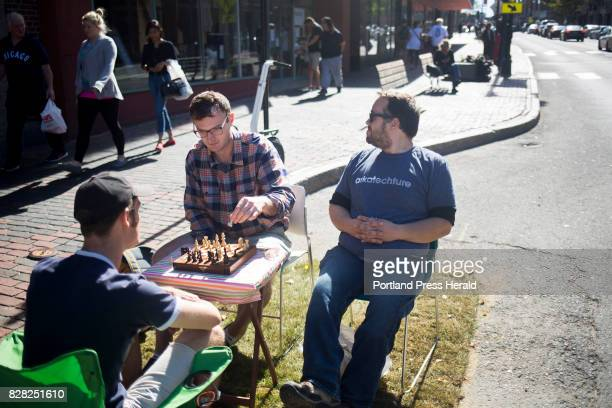 From left Skye Priestley and Chris Bond of Portland play chess in a parking spot on Congress Street that was transformed by Hack Portland and Code...