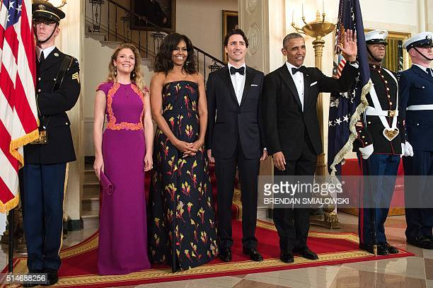 From left Sophie GregoireTrudeau US first lady Michelle Obama Canadian Prime Minister Justin Trudeau and US President Barack Obama pose for a photo...