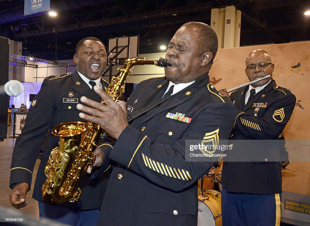 From left, Specialist Sylvester Allen Jr., Sgt. 1st Class Wayne White, and Staff Sgt. Michael Cheatham of the 208th Army Reserve Band 'Jazz Combo,' perform during opening evening events at the CIAA Fan Experience on Friday, March 1, 2013, at the Charlotte Convention Center, in Charlotte, North Carolina.