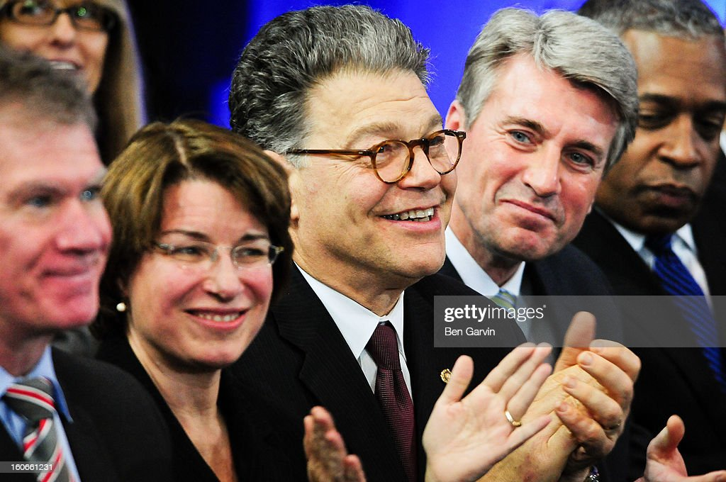 From left, St. Paul Mayor Chris Coleman, U.S. Sen. Amy Klobuchar (D-MN), U.S. Sen. <a gi-track='captionPersonalityLinkClicked' href=/galleries/search?phrase=Al+Franken&family=editorial&specificpeople=167079 ng-click='$event.stopPropagation()'>Al Franken</a> (D-MN), Minneapolis Mayor R.T. Rybak and U.S. Attorney for Minnesota B. Todd Jones listen as President Barack Obama speaks before a crowd of local leaders and law enforcement officials at the Minneapolis Police Department Special Operations Center on February 4, 2013 in Minneapolis, Minnesota. President Obama is promoting a ban on assault weapons and expanded background checks on gun buyers.