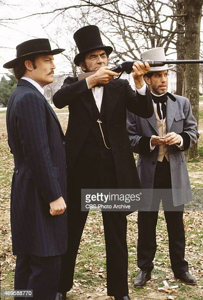 From left Stacy Keach Gregory Peck and David Rounds Lincoln is testing the Spencer repeating rifle in The Blue and the Gray The epic miniseries about...