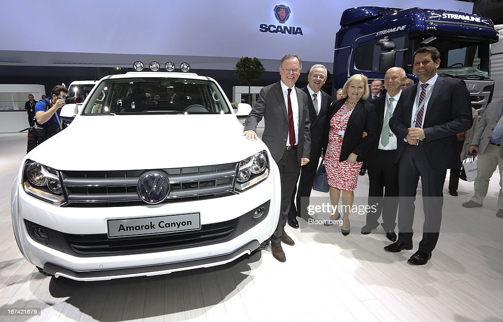 From left, Stephan Weil, a member of the board at Volkswagen AG, <a gi-track='captionPersonalityLinkClicked' href=/galleries/search?phrase=Martin+Winterkorn&family=editorial&specificpeople=840091 ng-click='$event.stopPropagation()'>Martin Winterkorn</a>, chief executive officer of Volkswagen AG, Ursula Piech, a member of the board at Volkswagen AG, Ferdinand Piech, chairman of Volkswagen AG, pose for a photograph next to a Volkswagen Amarok Canyon automobile ahead of the company's annual general meeting (AGM) in Hanover, Germany, on Thursday, April 25, 2013. Volkswagen AG, Europe's biggest automaker, aims to offset plunging European demand this year by rolling out 60 new and updated models, including luxury cruisers like the Bentley Flying Spur. Photographer: Chris Ratcliffe/Bloomberg via Getty Images