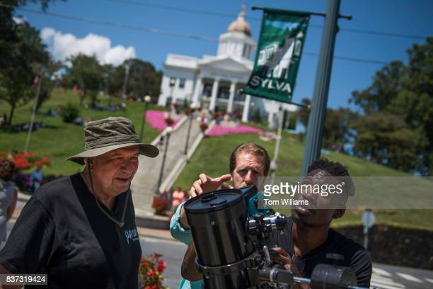 From left Steve Taynton Paul Pallante and Adeshola OkeBello set up a reflector telescope to view the solar eclipse in Sylva NC on August 21 2017 The...