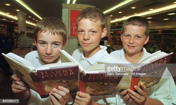 Steven Slatter Barnaby Cartwright and James Richards all aged twelve and from Henbury School in Bristol with their copies of the latest Harry Potter...