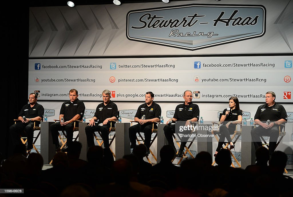 From left, Stewart-Haas Racing competition director Greg Zipadelli, NASCAR Sprint Cup Series driver Ryan Newman, crew chief Matt Borland, driver/owner Tony Stewart, crew chief Steve Addington, driver Danica Patrick and crew chief Tony Gibson address the media during the Sprint NASCAR media tour on Monday, January 21, 2013, in Concord, North Carolina.